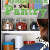 woman looking into a pantry cabinet with containers of food