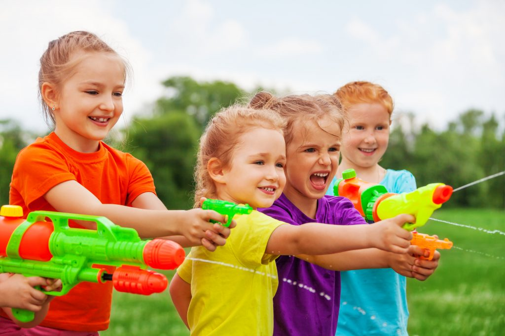 summer fun for kids: young kids playing with water guns