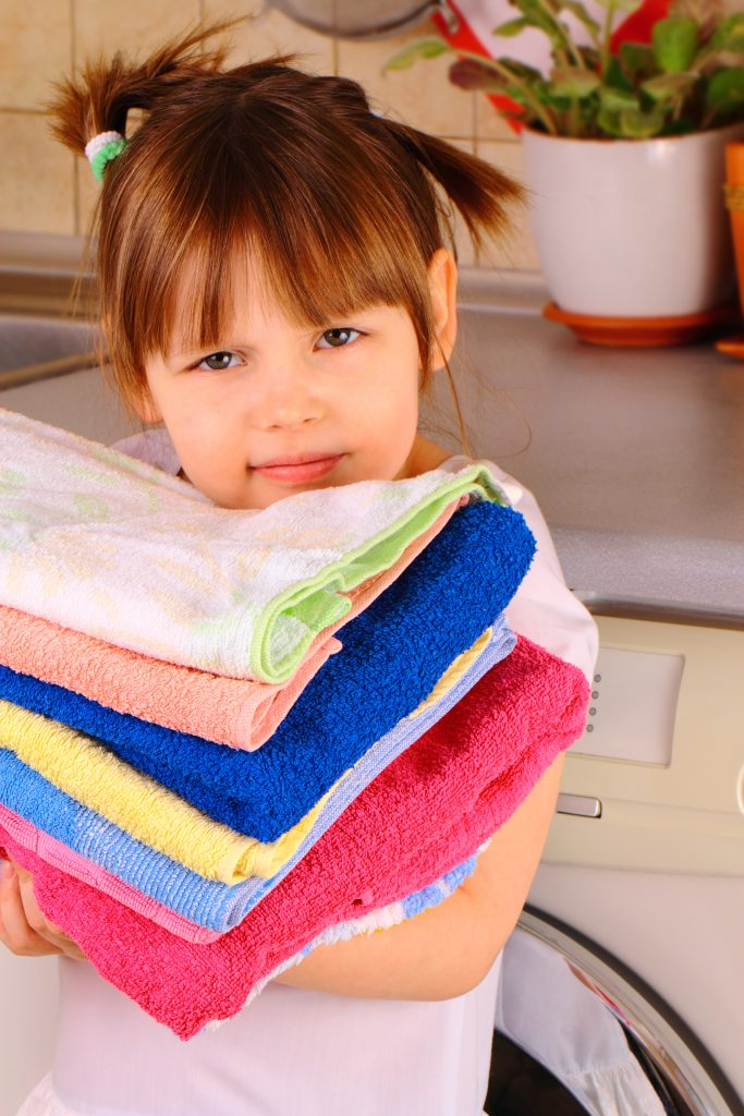 image kids chores little girl holding folded towels