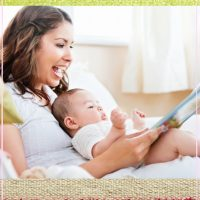happy mommy reading to small baby