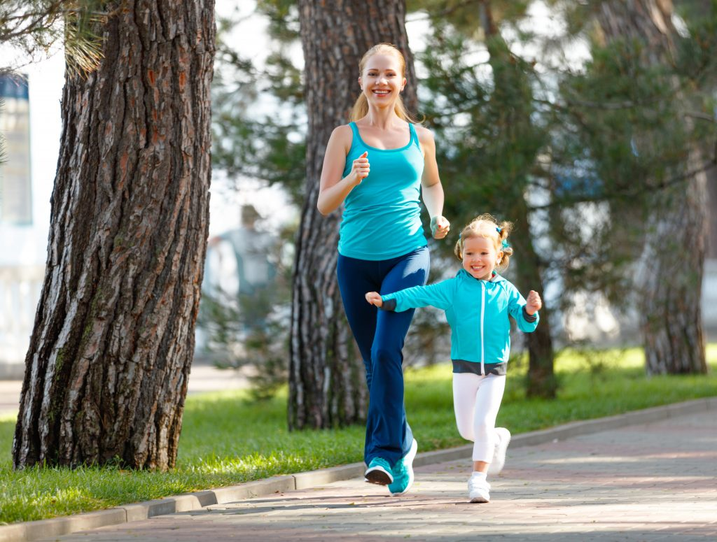mom and young daughter jogging