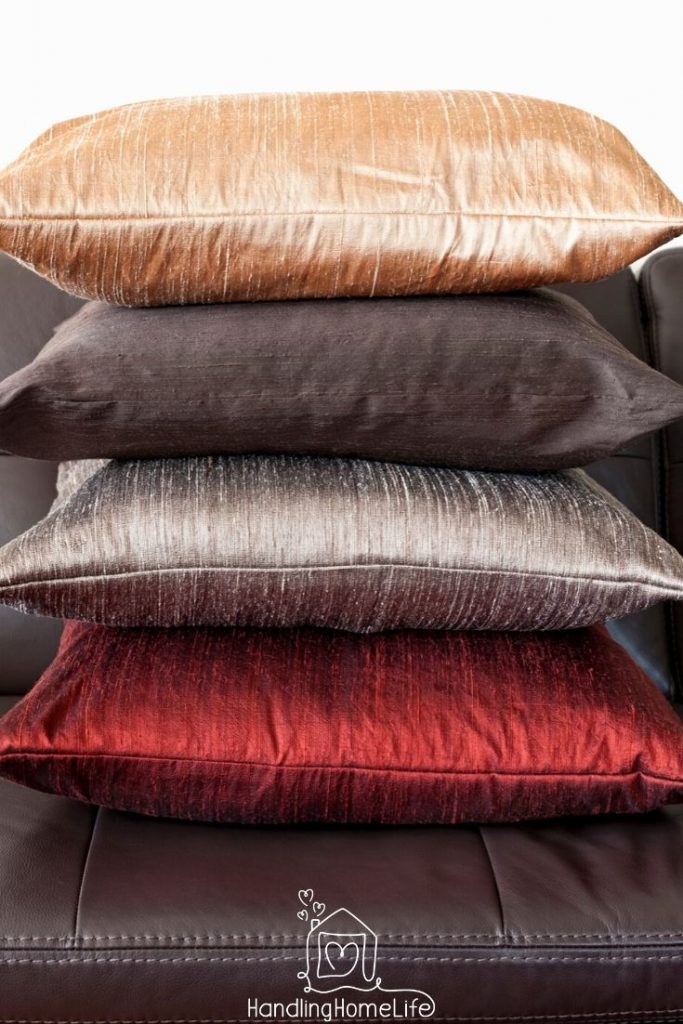 cushions on a leather sofa: decluttering tips