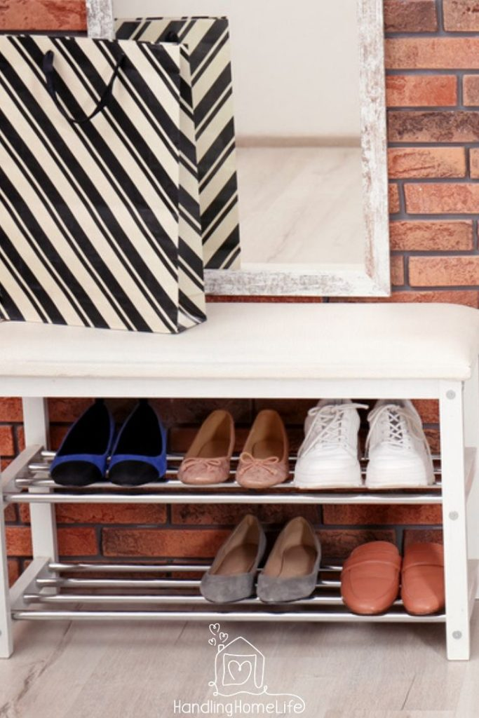 House cleaning tips:  shoe rack with shoes next to the front door