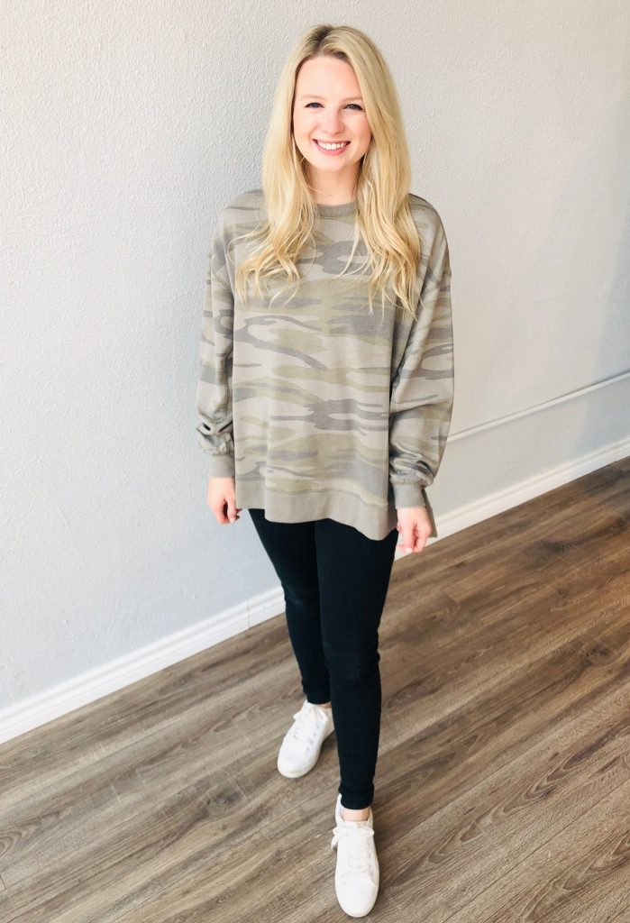 Trendy camo pullover with black leggings