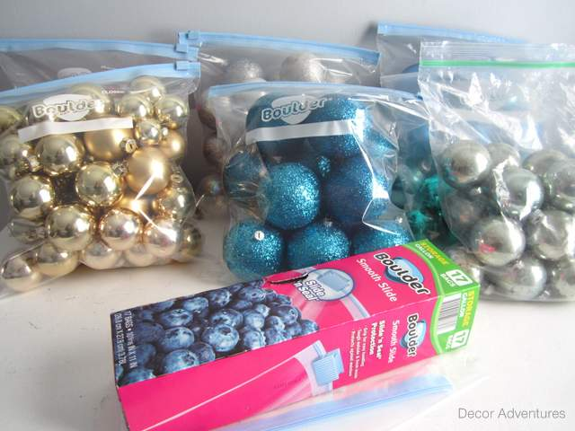 christmas ornaments organized by color in zippered plastic bags