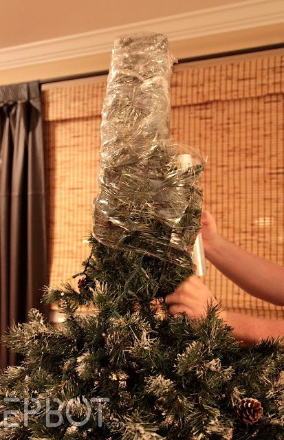 Christmas tree being shrink wrapped before storage