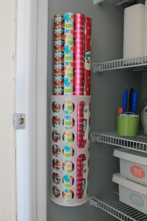 christmas gift wrap rolls stored in Ikea plastic bag dispenser