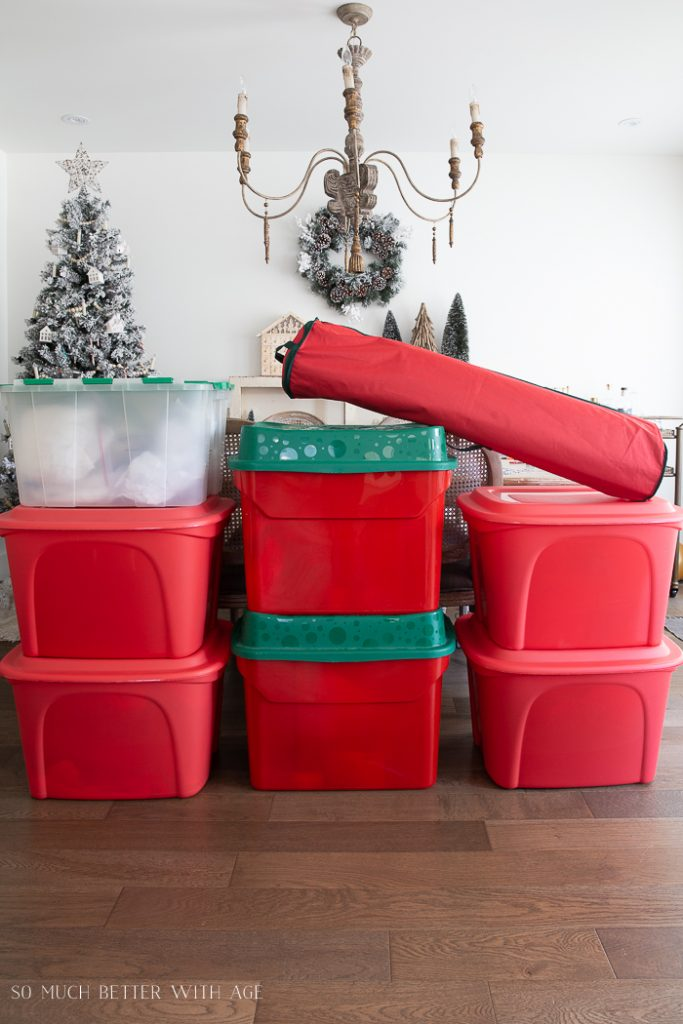 Christmas decorations stored green and red storage tubs