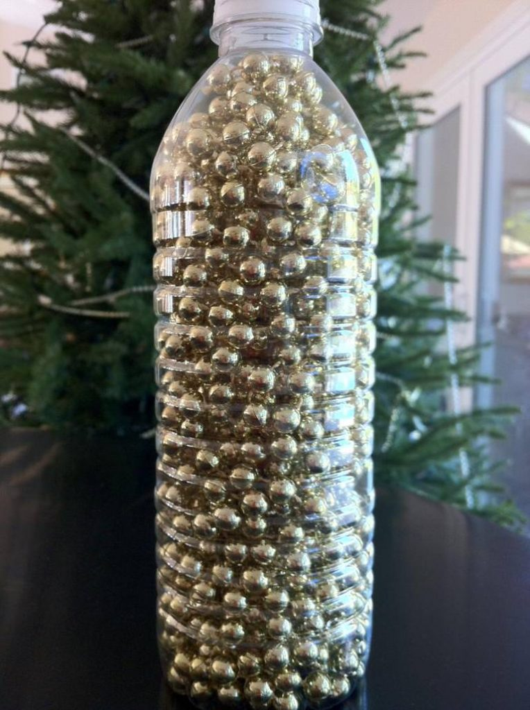 repurposed water bottle with a strand of beads inside for storage